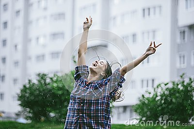 Woman happy smiling happiness hands outstretched toward the rain