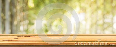 Wooden board empty table blurred background. Perspective brown wood table over blur trees forest background.