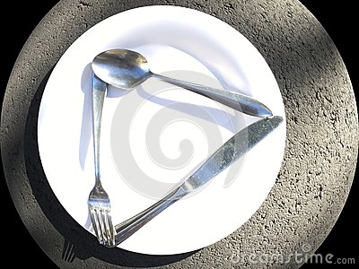A common, brilliant white dinner plate with eating utensils knife, fork and spoon.