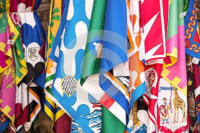Flags of the Siena contrade districts, Palio festival background, in Siena, Tuscany Italy