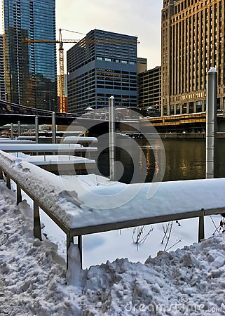 Sunset over a snowy Chicagoland and Chicago River in winter.