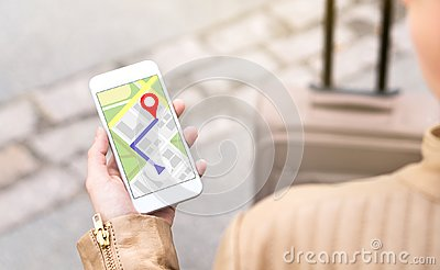 Woman navigating with mobile phone map application.
