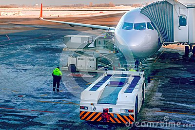 Aircraft being attached to jetway or passenger telescopic gangway on the airport apron. Prepares for boarding passengers.