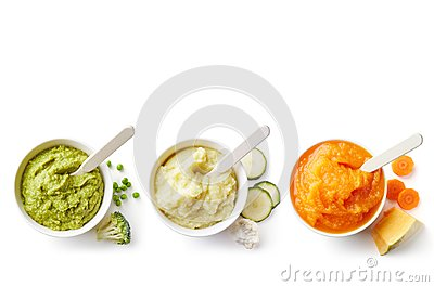 Three bowls of baby puree isolated on white from above