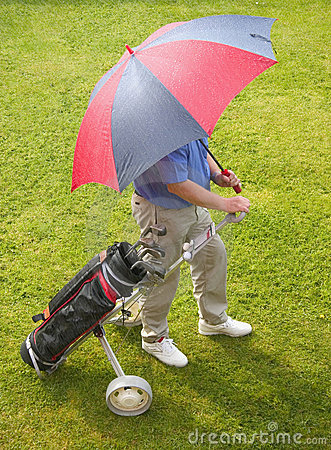Golfer and umbrella