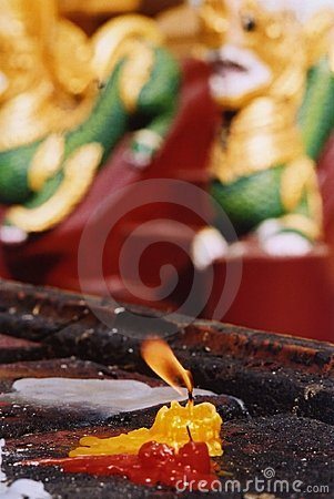 Candle burning in a pagoda
