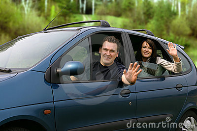 Couple Traveling In The Car