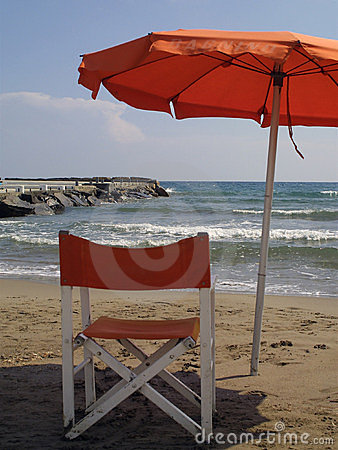 Chair and umbrella on beach