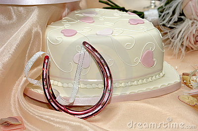 Wedding cake and horse shoe charm