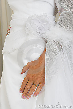Hand on wedding gown