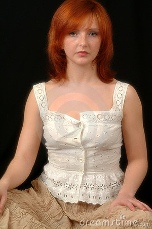 Portrait Of Red Head In White Blouse