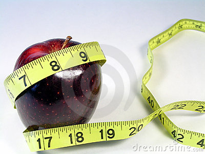 Red apple and yellow tape measure