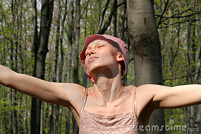 Happy woman  - meditation in the forest