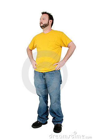Casual Man In Baggy Pants And Yellow Shirt Over White