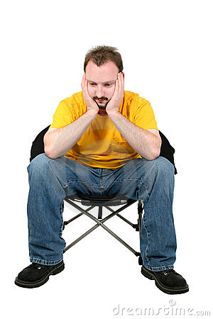 Casual Man Upset Sitting In Chair Over White