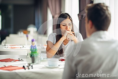 Distracted pensive woman thinking,not listening conversation.Emotional mental problems.Issues in marriage and relationship
