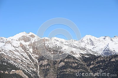 Mountains covered with snow and overgrown with spruce - The Principality of Andorra, Pyrenees, Europe.