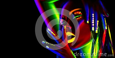 Fashion model woman in neon light. Beautiful model girl with colorful fluorescent makeup