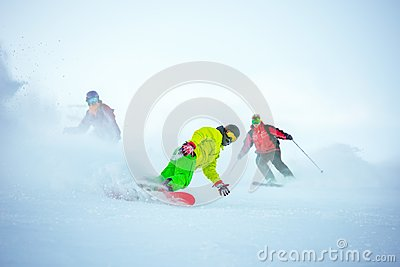 Ski downhill concept with group of snowboarders