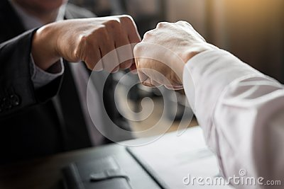 Business Partners Giving Fist Bump to commitment Greeting Start
