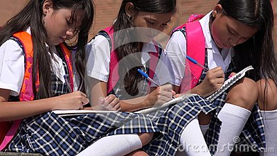 Catholic School Children Writing Wearing School Uniforms