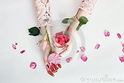 Fashion art portrait woman in summer dress and flowers in her hand with a bright contrasting makeup. Creative beauty photo girls