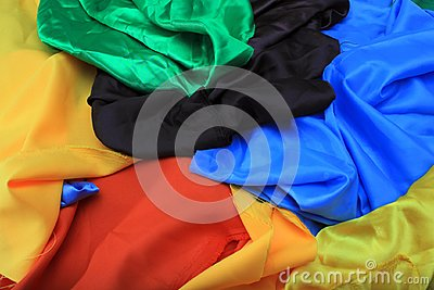 Pile of colorful silk fabrics. Crumpled patches of vibrant color