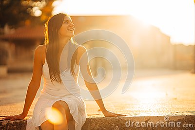 Carefree woman enjoying in nature, beautiful red sunset sunshine. Finding inner peace. Spiritual healing lifestyle. Enjoying peace