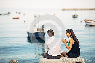 Romantic couple having relationship problems.Woman crying and begging a man.Fisherman life,dangerous occupation.Navy sailors