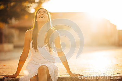 Carefree woman enjoying in nature,beautiful red sunset sunshine.Finding inner peace.Spiritual healing lifestyle.Enjoying peace,ant