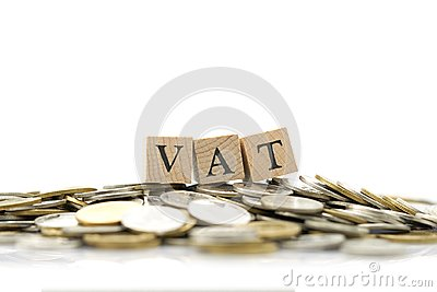Wood word VAT is placed on a pile of coins.using as background business concept and finance concept with copy spaces