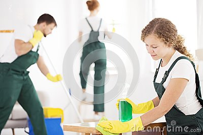 Cleaning specialist using detergent