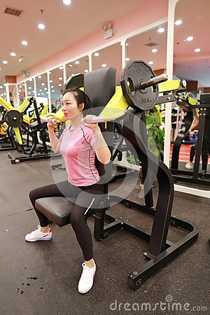 Woman in gym Weight Train