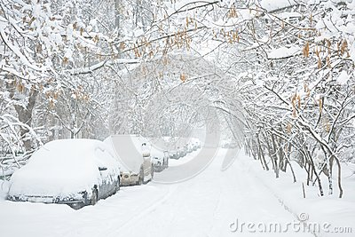 Street during snowstorm at winter in Moscow, Russia