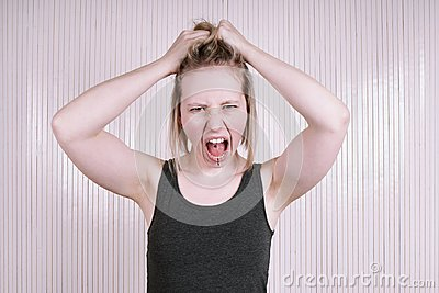 Outraged young woman having a temper tantrum shouting and screaming