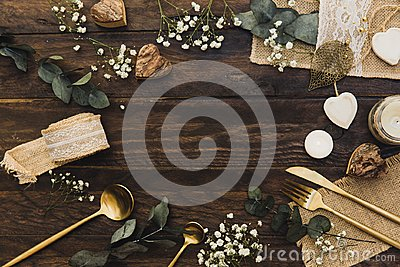 Details of a rustic wedding over wooden background. Flat Lay, Top View