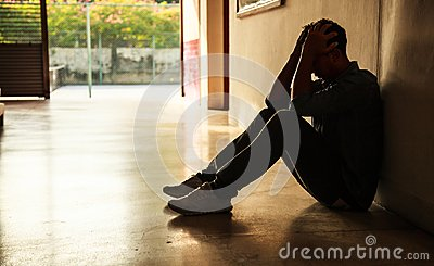 Emotional moment: man sitting holding head in hands, stressed sad young male having mental problems, feeling bad, depressed