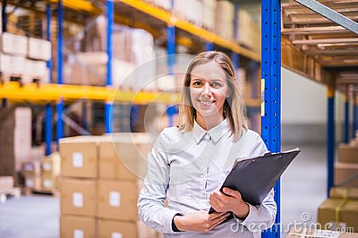 Portrait of a woman warehouse worker or supervisor.