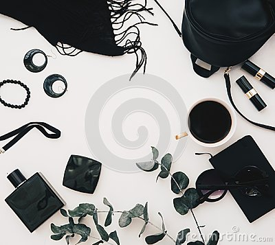 stock image of flat lay feminine accessories collage with black dress, glasses, watch, mascara