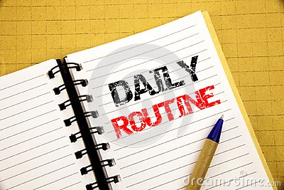 Daily Routine. Business concept for Habitual Lifestyle written on notepad with copy space on old wood wooden background with pen m