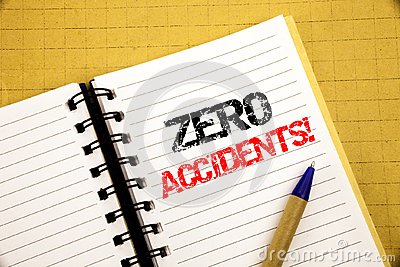 Zero Accidents. Business concept for Safety At Work Hazard written on notepad with copy space on old wood wooden background with p