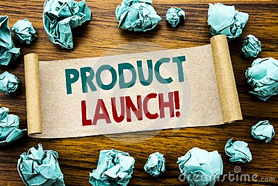 Word, writing Product Launch. Business concept for New Products Start Written on sticky note paper, wooden background with folded