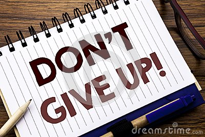 Hand writing text caption inspiration showing Don t Give Up. Business concept for Motivation Determination, Written on notebook no