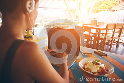 Freelancer working at laptop in caffe