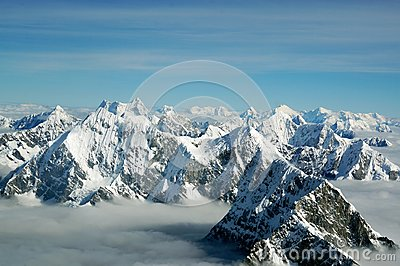 The tops of the Himalayan mountains above the clouds, view from the airplane. Nepal.