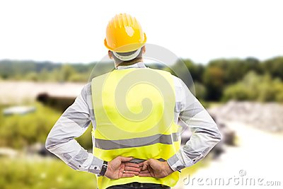 Injured construction worker or engineer suffering backpain