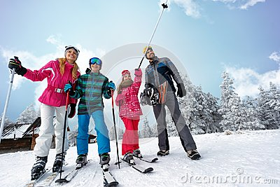 stock image of family sport skiing and snowboarding time on sunny day