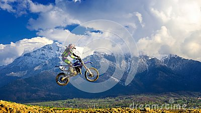 Young girl with motocross bike in Romania. Extreme sports