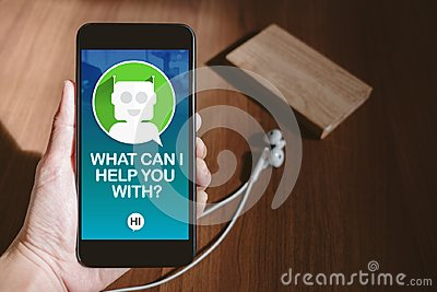 User hand holding mobile chatting with chat bot on phone screen