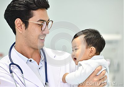 Asian paediatrician is taking care of baby